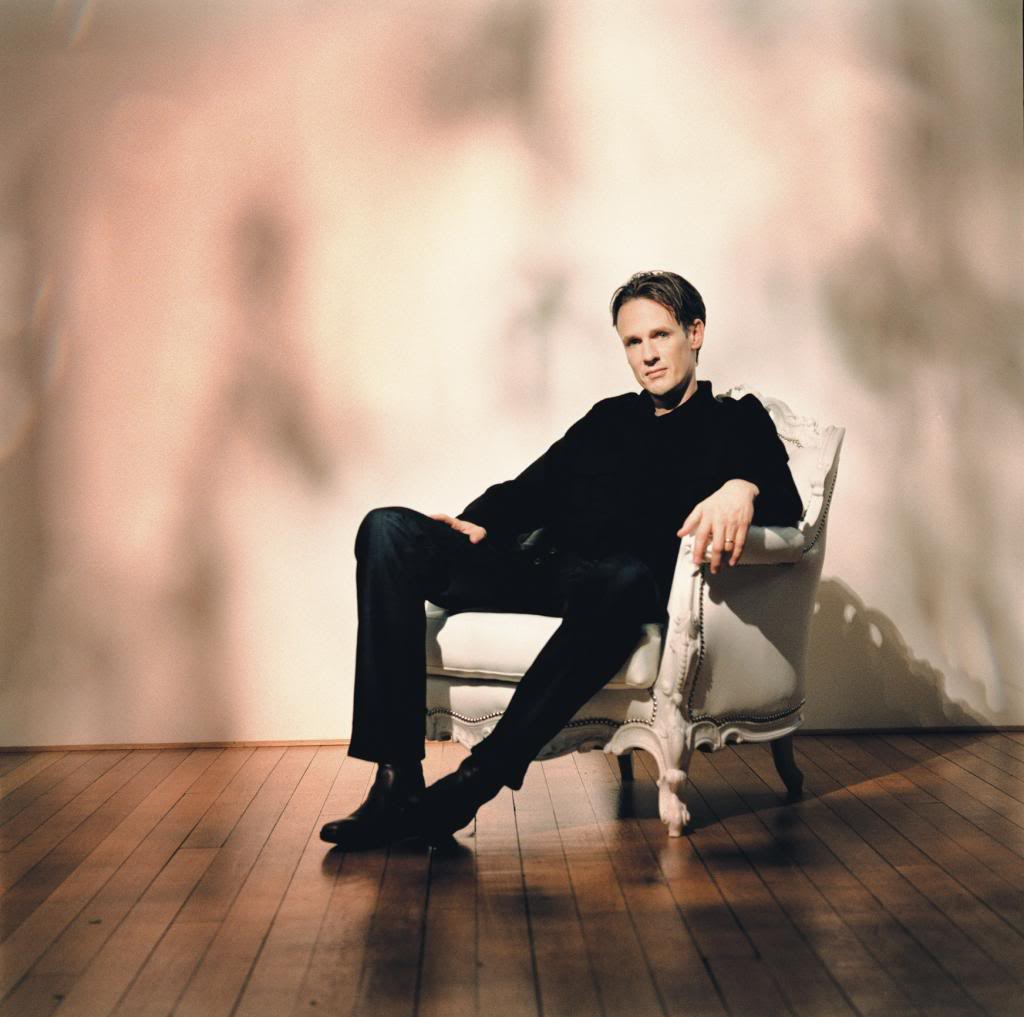 Ian Bostridge reclining on a chair